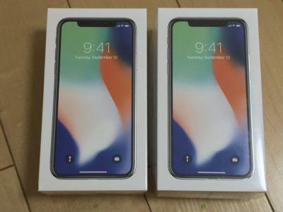 2台のiPhoneX、シルバー、箱の写真を撮影
